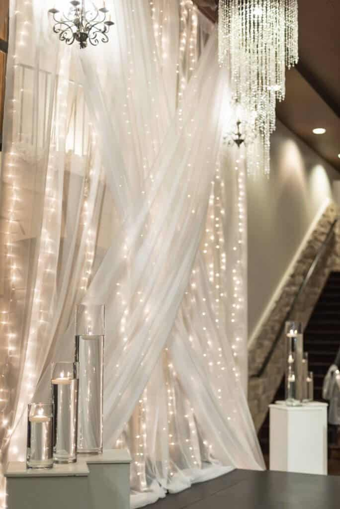 A-Dramatic-Modern-fabric-ceremony-backdrop-Criss-cross-684x1024