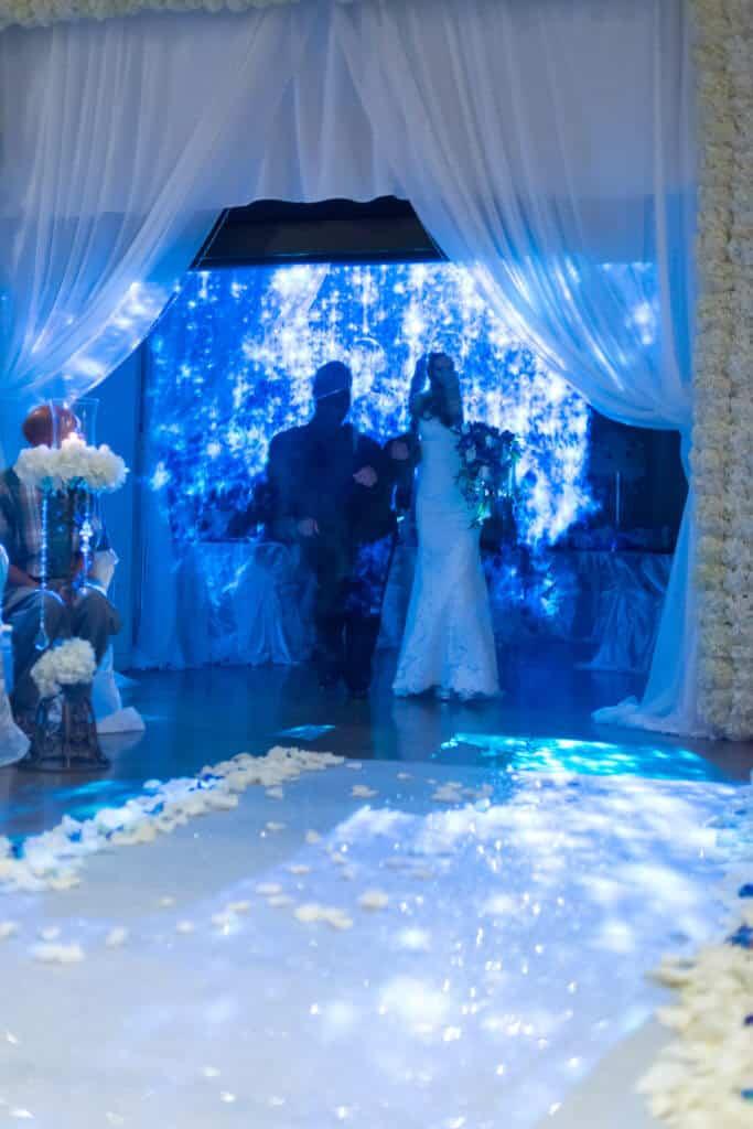 Blue-glitter-animation-on-FogScreen-683x1024