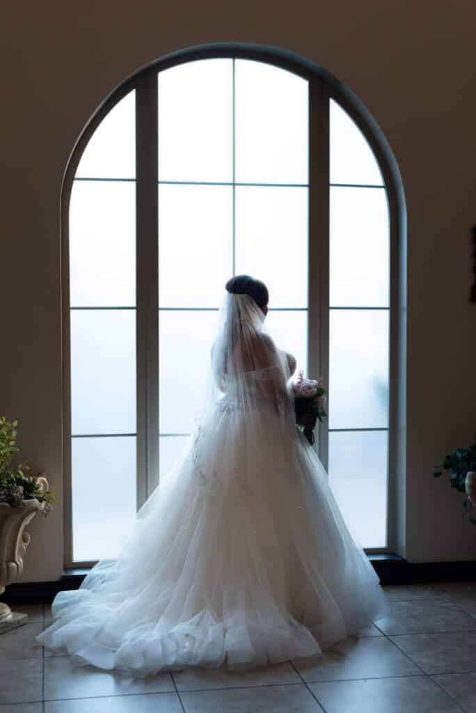 Bride-by-window-photo-at-Bella-Sera_3230-1-684x1024