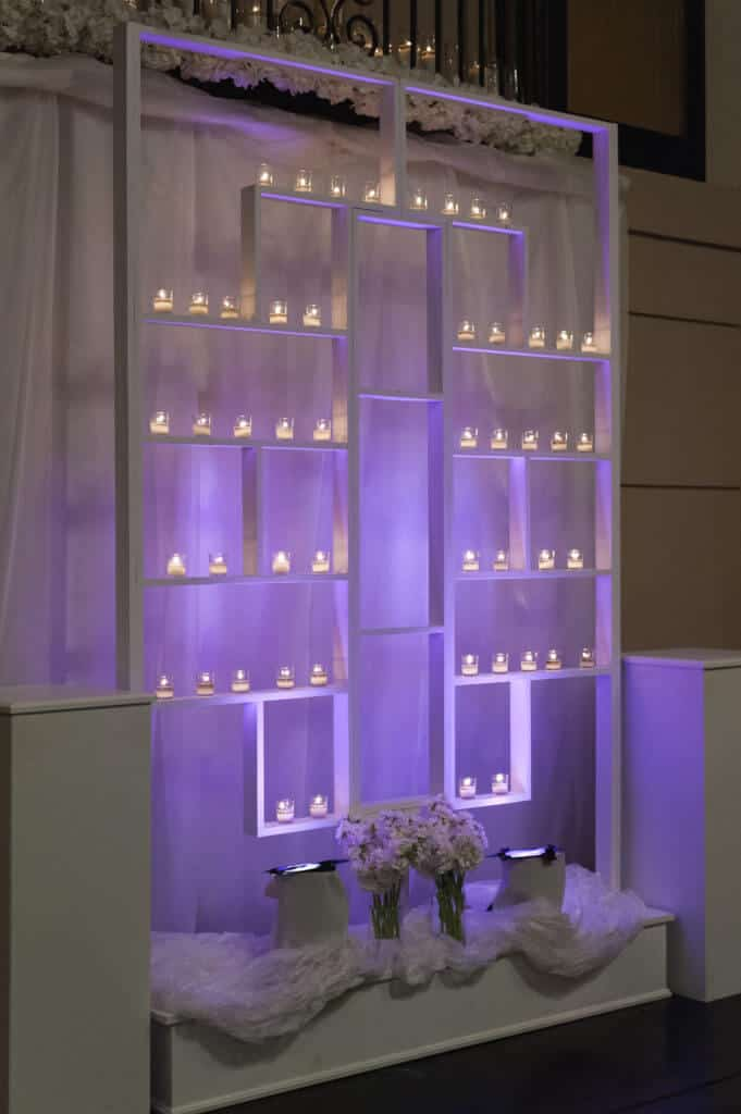 Candlelit-Purple-Shelves-of-candles-ceremony-backdrop-4659--681x1024