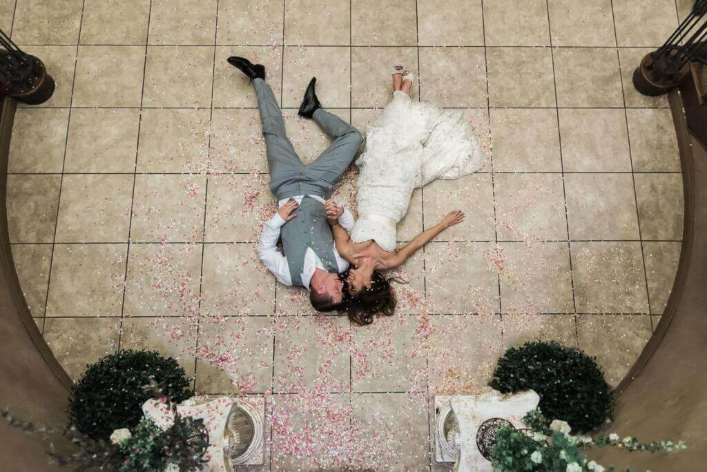 Couple-laying-on-Lobby-floor-in-petals-1024x684