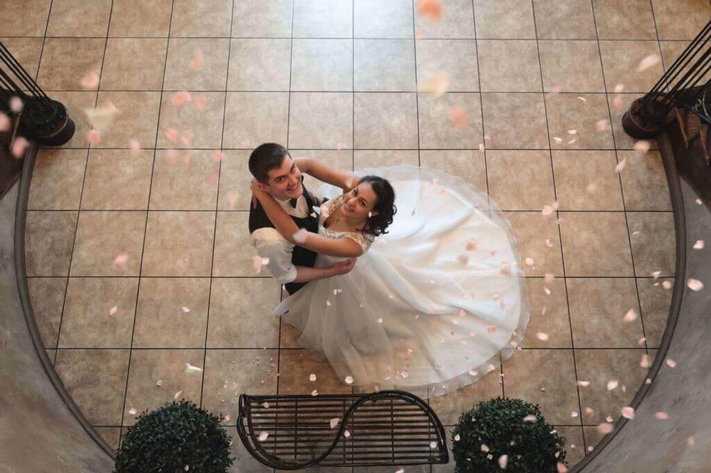Falling-flower-petals-bride-and-groom-7AP_8474-1024x681