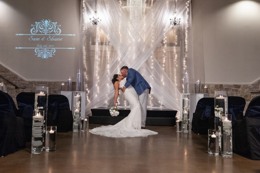 Bold-Twinkle-lights-on-Criss-cross-fabric-ceremony-backdrop-2986--1024x681