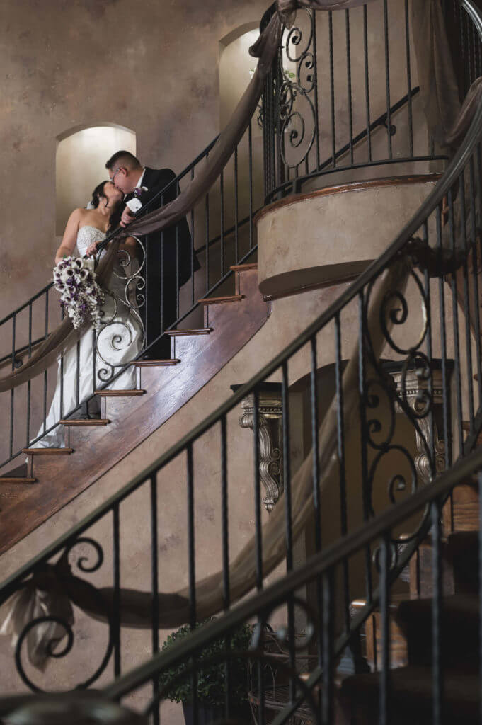 Breathtaking-photo-of-bride-and-groom-on-grand-staircase-681x1024