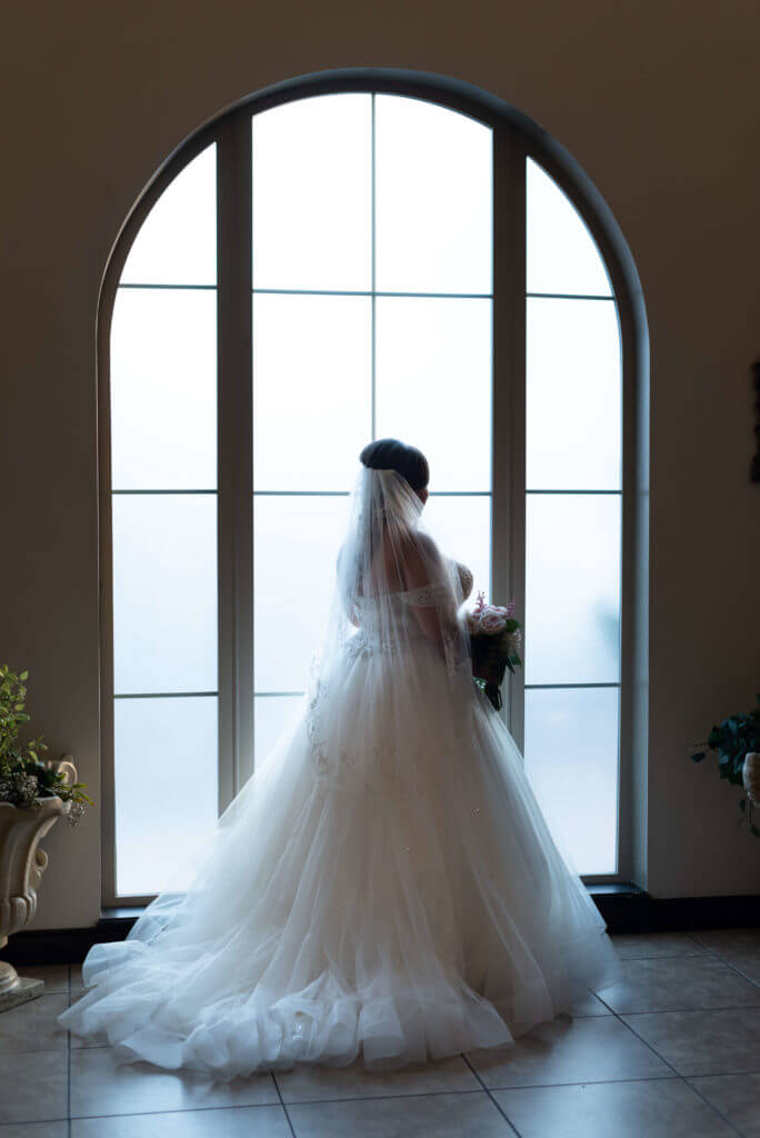Bride-by-window-photo-at-Bella-Sera_3230-1-684x1024