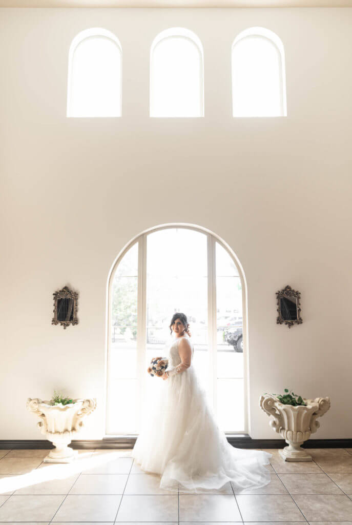 Photograph-of-bride-in-curved-window-2TG05262-687x1024